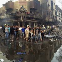 Shiite militia taking charge after massive blast shattered Baghdad's bastion of diversity