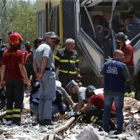 Probe into deadly Italy train crash looks at antiquated traffic control, delayed updates
