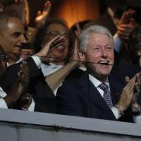Former President Bill Clinton applauds as first lady Michelle Obama speaks during the first day of the Democratic National Convention in Philadelphia  Monday. | AP