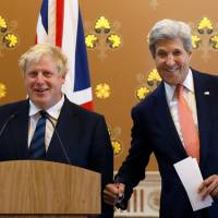 British Foreign Secretary Boris Johnson and U.S. Secretary of State John Kerry joke together during a news conference at the Foreign Office in London on Tuesday.   REUTERS