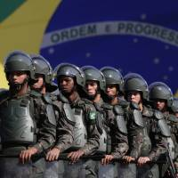 Brazilian soldiers take part in a presentation of security forces for the Rio 2016 Olympics in Brasilia on Friday. | AP