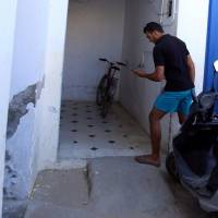 Jabeur Lahouaiej Bouhlel, the brother of Mohamed Lahouaiej Bouhlel, the man who drove a heavy truck into crowds in the French city of Nice killing at least 84 people on Friday, holds his phone near his house in Msaken, Tunisia, Friday.   REUTERS