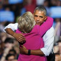 President Barack Obama embraces Democratic presidential candidate Hillary Clinton during a campaign rally for Clinton Tuesday in Charlotte, North Carolina. | AP