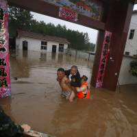 Three days of heavy rain in China leave 50 dead, 12 missing