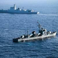 Ships from China's South Sea Fleet taking part in a drill in the Paracel Islands in the South China Sea in May. | AFP-JIJI