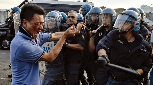 Italy's biggest Chinese community clashes with police in textile town near Florence