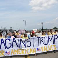 Protesters against racism and hate demonstrate against Republican presidential nominee Donald Trump in Cleveland on Thursday. | FINBAR O'MALLON