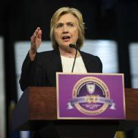 Clinton tries to move on, deflects email blame on officials