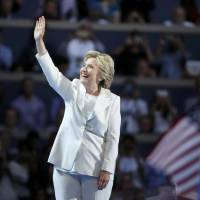 Clinton accepts nomination, pledges progress and a steady hand at 'moment of reckoning'