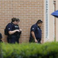 After gunman shoots five police officers dead, new security scare jolts shell-shocked Dallas