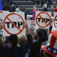 Delegates show their opposition to the Trans-Pacific Partnership deal during Day 1 of the Democratic National Convention in Philadelphia on Monday.   AFP-JIJI