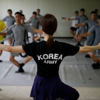 Once a week a group of South Korean soldiers near the Demilitarized Zone that divides the Korean peninsula trade army boots for ballet shoes in a class intended to ease the stress of guarding the world's most heavily fortified border. | REUTERS