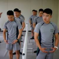 South Korean soldiers take part in a ballet class at a military base near the Demilitarized Zone separating the two Koreas in Paju, South Korea, on Wednesday. | REUTERS