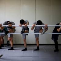 Wearing shorts and T-shirts along with their dancing slippers, members of the South Korean Army's 25th Division are taught each week by a ballerina from the Korean National Ballet. | REUTERS
