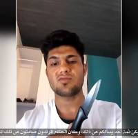 An image from an undated video the Islamic State group posted Tuesday shows the Afghan refugee who allegedly attacked passengers with an ax on a train in Germany.   SOCIAL MEDIA VIA REUTERS TV