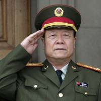 Former top Chinese general sentenced for taking bribes