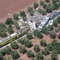 At least 22 killed as commuter trains crash head-on in southern Italy olive grove