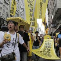 Hong Kong says freed bookseller can't be sent back to China