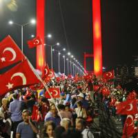 Thousands of Erdogan supporters take to Bosphorus Bridge to denounce foiled coup