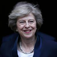May wins battle to be next British leader but faces tough times over Brexit