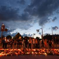 Munich shooter planned attack for year, was a bullied loner; Afghan friend, 16, held