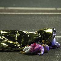 A Nice attack victim lies on the ground early Friday.   REUTERS
