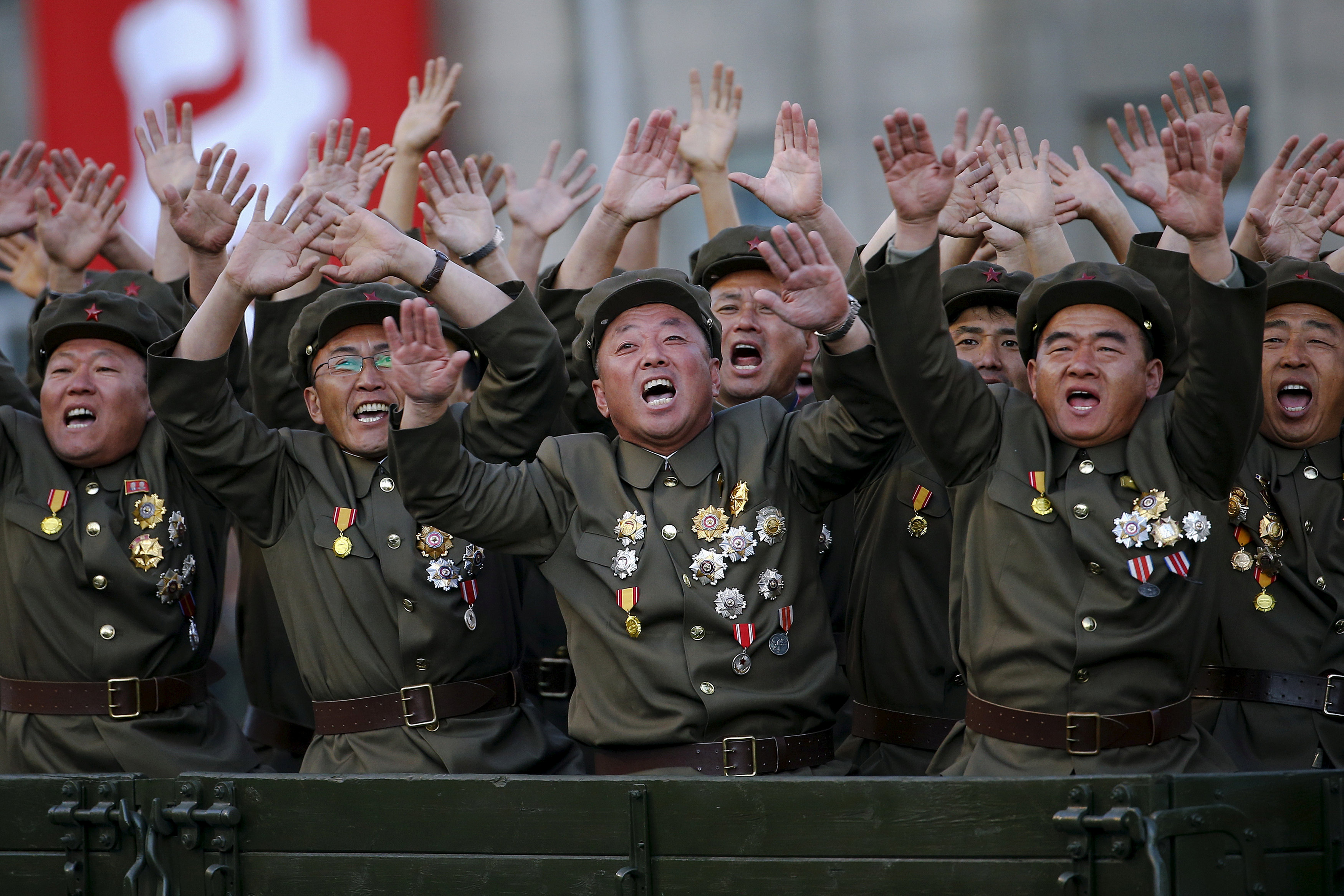 Veteran soldiers react as their truck drives past North Korean leader Kim Jong Un during a parade celebrating the 70th anniversary of the founding of the ruling Workers' Party of Korea in Pyongyang last October.   REUTERS
