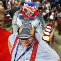 A convention goer wears a GOP mascot elephant hat at the Republican National Convention in Cleveland Monday. | REUTERS