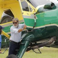 Checklist complete, Harrison Ford takes teen on Oshkosh touch and go