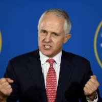 Australian newspaper poll shows coalition leading by 50.5 percent to Labor's 49.5 percent in general election
