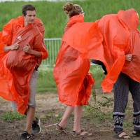 Pilgrims attending the World Youth Day event leave in the rain following a Mass celebrated by Pope Francis in the Campus Misericordiae in Brzegi, near Krakow, Poland, on Sunday.   AFP-JIJI