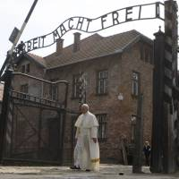 Pope Francis visits Auschwitz, meets survivors, begs God to forgive 'so much cruelty'