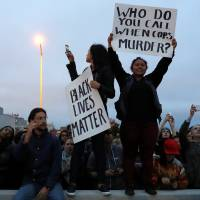 U.S. protesters come together over police shootings