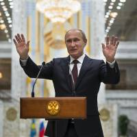 Russian President Vladimir Putin speaks to the media after talks in Minsk in this August 2014 file photo. Russia has said it was not involved in the hacking of the Democratic Party email system, but experts say Russia had motive, capability and form.   REUTERS
