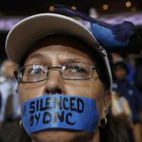 Sanders disciples rebel against him as he tries to keep them on DNC message