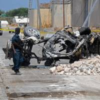 13 killed as two suicide-bomb cars blow up near U.N., AU offices in Mogadishu