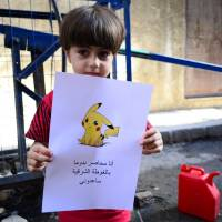 Amid craze, Syrian children hold Pokemon pictures, pray 'world will find them'