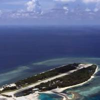 This handout picture taken and released Wednesday shows a general view of Taiping island in the South China Sea. | THE OFFICE OF KUOMINTANG (KMT) LAWMAKER JOHNNY CHIANG / AFP-JIJI