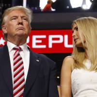 Republican presidential nominee Donald Trump stands in the Trump family box with his daughter Ivanka awaiting the arrival onstage of his son Eric at the Republican National Convention in Cleveland on Wednesday.   REUTERS
