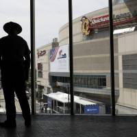 A trooper looks out to Quicken Loans Arena as preparations take place for the Republican National Convention  Sunday in Cleveland.   AP