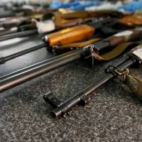 Confiscated weapons are seen at a police station in Slovyansk, in Ukraine's Donetsk region, on June 30. | REUTERS