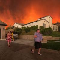 Thousands may have to flee as California wildfire guts 18 homes, roars down hills 'like a freight train'