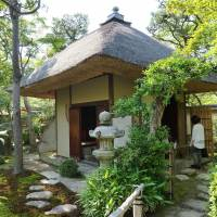 A tea house with a thatched roof hut that was relocated from Otokoyama and restructured to recreate the place where Shojo spent his last years. | KYODO
