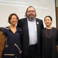 Theodore Bestor (center), a professor of anthropology and director of the Reischauer Institute of Japanese Studies at Harvard University, poses for a photo with the producers of 'Tsukiji Wonderland,' Maiko Teshima (left) and Kazuha Okuda, in Tokyo on July 11.  KYODO