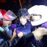An injured police officer is carried away by colleagues after gunmen stormed a restaurant popular with expatriates in the diplomatic quarter of the Bangladeshi capital, Dhaka, on Friday. | REUTERS
