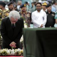 Masato Watanabe, Japan's ambassador to Bangladesh, attends a ceremony Monday at a stadium in Dhaka in remembrance of the victims of the attack on the Holey Artisan Bakery in the Bangladeshi capital. | AP