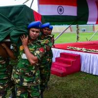 Bangladeshi soldiers taking part in a memorial service Monday in Dhaka carry the coffin of a police officer killed in last week's terrorist attack. | AFP-JIJI