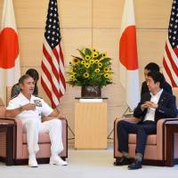 Adm. Harry B. Harris Jr., head of the U.S. Pacific Command, speaks with Prime Minister Shinzo Abe during a courtesy call at his official residence in Tokyo on Tuesday. | AP