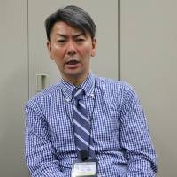 Toshihiko Matsumoto, a doctor who developed a program to treat substance dependence, speaks at the National Institute of Mental Health in Kodaira, Tokyo, on June 8. | KYODO