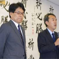 Former internal affairs minister Hiroya Masuda (left) and Nobuteru Ishihara, chairman of the Liberal Democratic Party's Tokyo chapter, talk with supporters after the election loss at Masuda's campaign office in Tokyo's Chiyoda Ward on Sunday. | KYODO